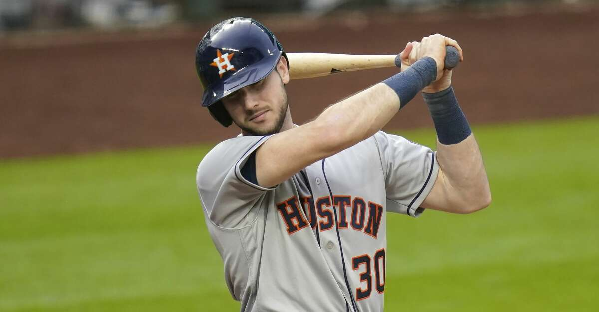 Houston Astros' Kyle Tucker turns away from an inside pitch against the Seattle Mariners in a baseball game Tuesday, Sept. 22, 2020, in Seattle. (AP Photo/Elaine Thompson)