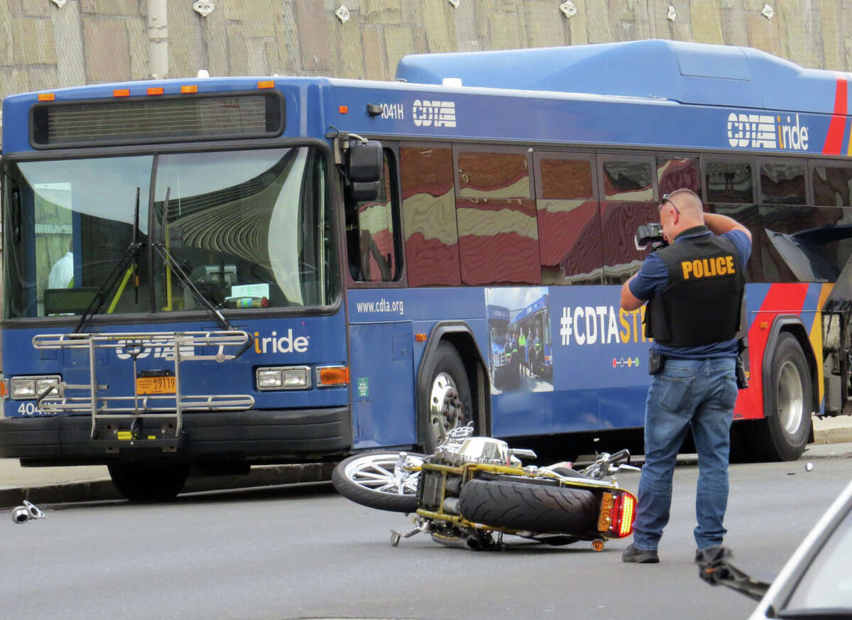 Police investigate a fatal motorcycle crash on Thursday evening, Sept. 24, 2020, across from the State Museum on Madison Avenue in Albany, N.Y. The collision involved a vehicle and a parked CDTA bus. (Thomas Heffernan Sr./Special to the Times Union)