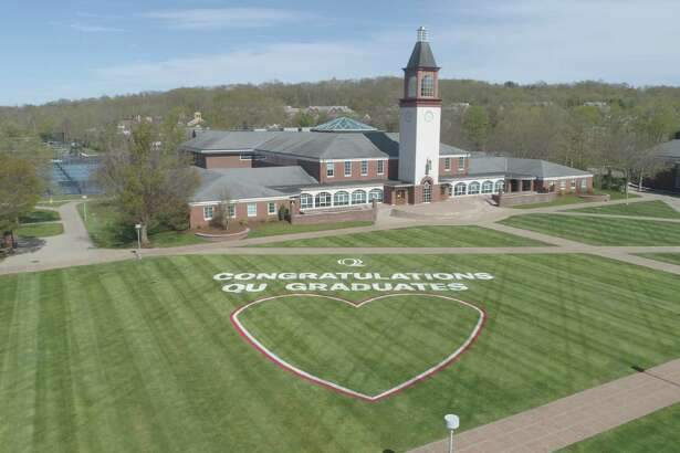A message to the graduation class at Quinnipiac University painted on the grounds of the Mount Carmel Campus in Hamden