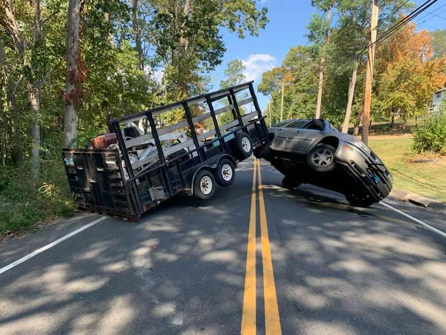 Route 74 was closed for about an hour after a passenger car towing a trailer jack-knifed in South Windsor Conn. Wednesday, Sept. 23. Photo: Contributed / South Windsor Fire Department