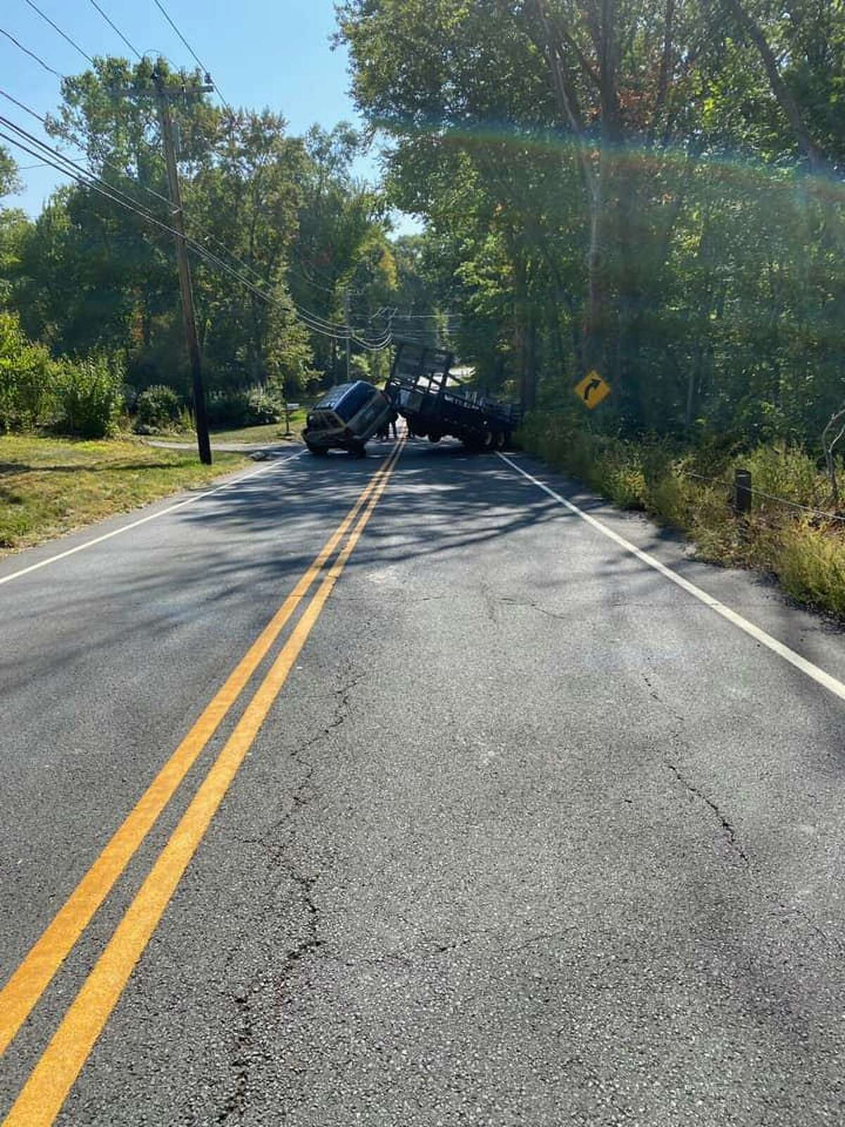Route 74 was closed for about an hour after a passenger car towing a trailer jack-knifed in South Windsor Conn. Wednesday, Sept. 23.