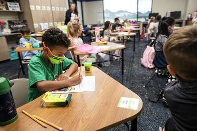 First grader Blake Diaz colors a worksheet on his first day of in-person classes at McElwain Elementary School on Tuesday, Sept. 8, 2020 in Katy.