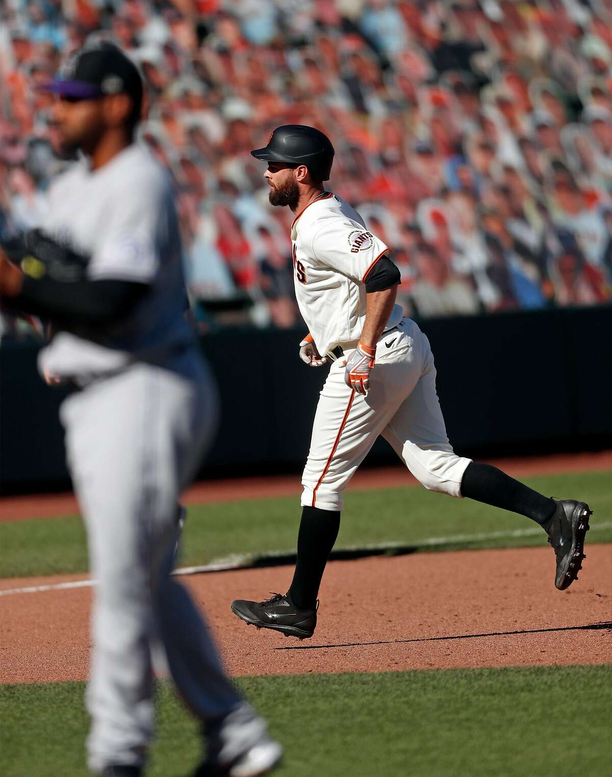 San Francisco Giants' Brandon Belt hits game-tying home run in 8th inning against Colorado Rockies in MLB game at Oracle Park in San Francisco, Calif., on Thursday, September 24, 2020.