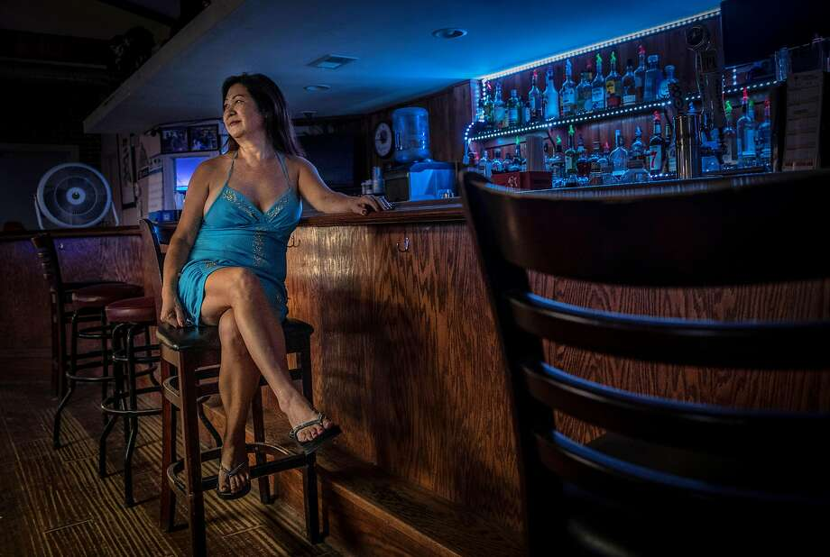 Yong Simas owns Yong's Bar & Grill in Holt. She's lived in the delta region for decades and lives in a mobile home behind her business. Photo: Carlos Avila Gonzalez / The Chronicle