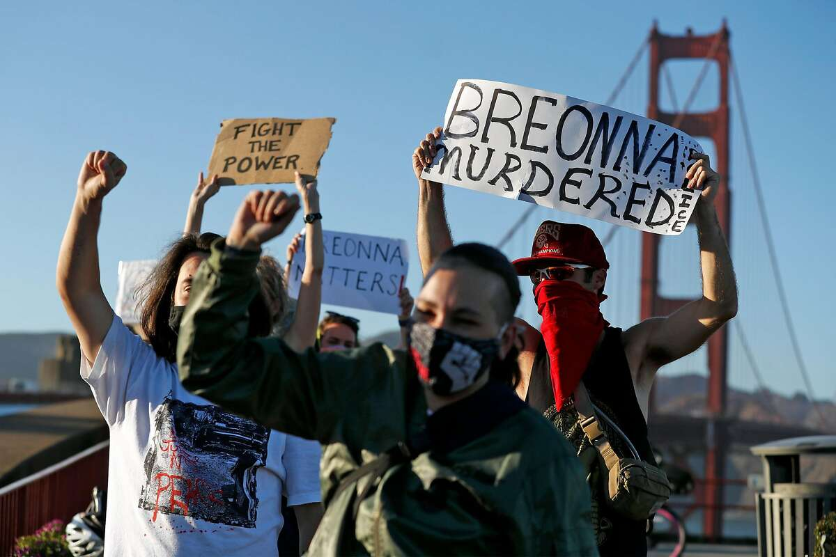 A small group of protesters demonstrate on the south end of the Golden Gate Bridge in San Francisco, Calif., on Thursday, September 24, 2020, against the lack of murder charges in shooting of death of Breonna Taylor.