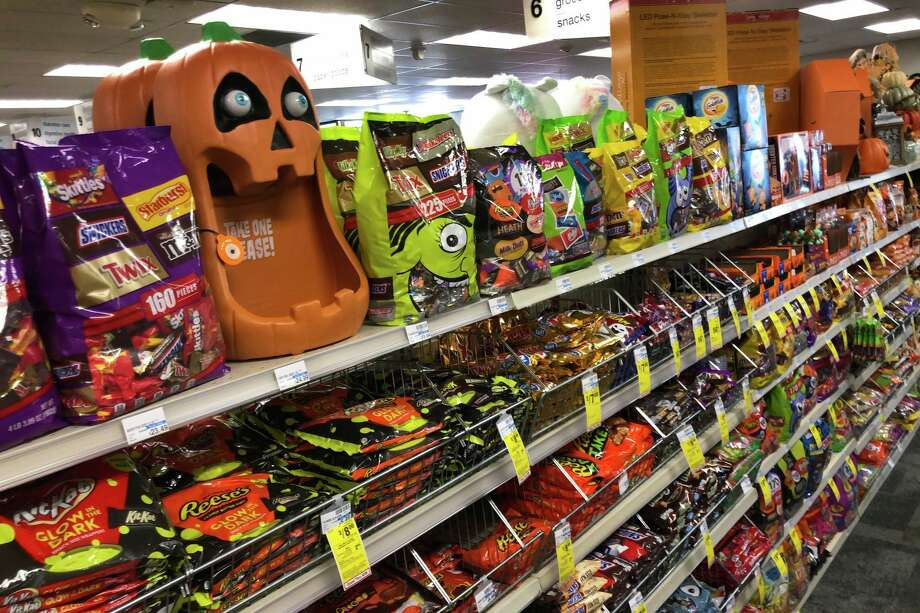 Halloween candy and decorations are displayed at a store, Sept. 23, 2020, in Freeport, Maine. U.S. sales of In this year of the pandemic, with trick-or-treating still an uncertainty, Halloween candy were up 13% over last year in the month ending Sept. 6, according to data from market research firm IRI and the National Confectioners Association. (AP Photo/Robert F. Bukaty) / Copyright 2020 The Associated Press. All rights reserved.