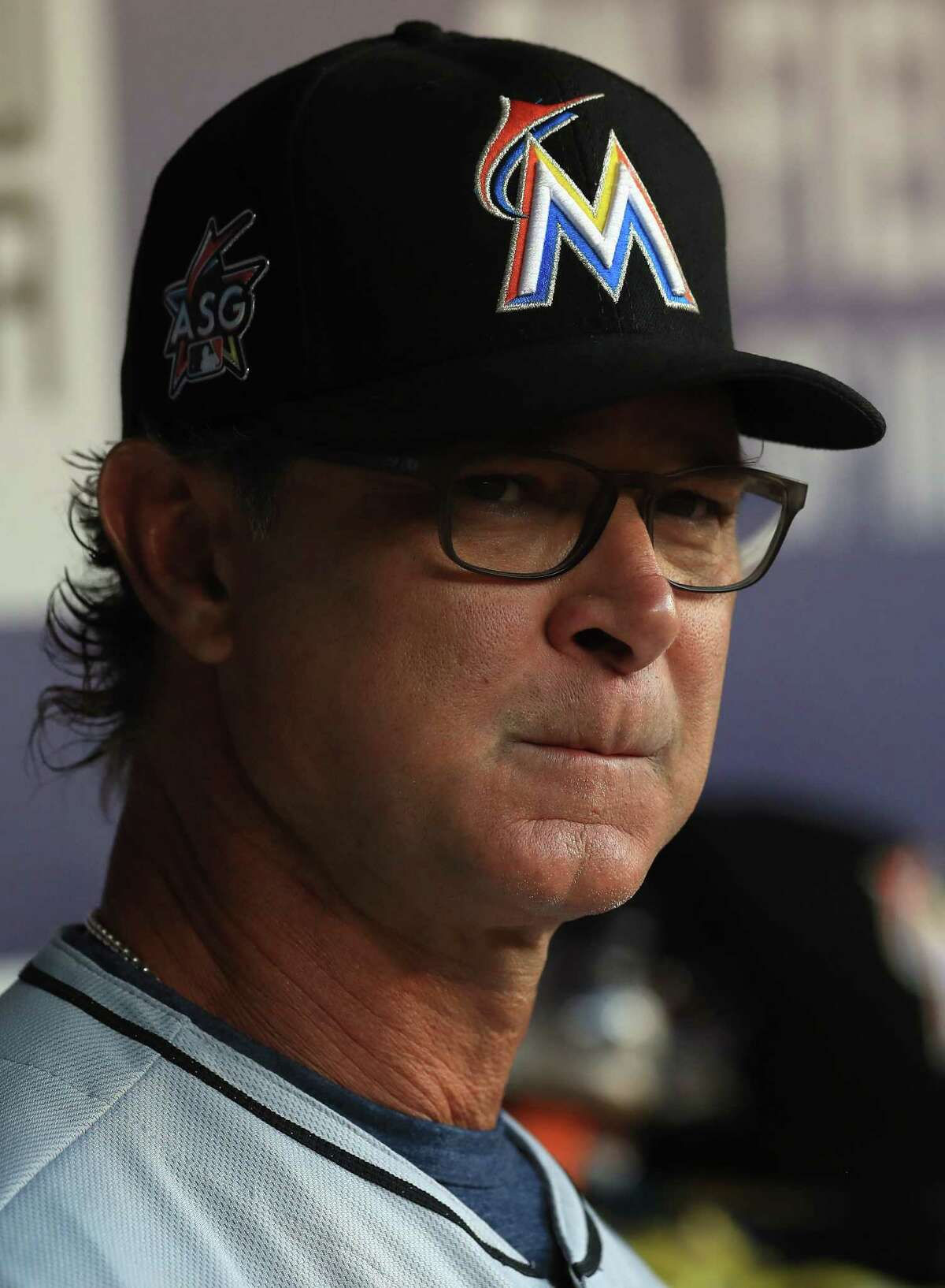 ARLINGTON, TX - JULY 25: Manager Don Mattingly #8 of the Miami Marlins in the first inning against the Texas Rangers at Globe Life Park in Arlington on July 25, 2017 in Arlington, Texas. (Photo by Ronald Martinez/Getty Images) ORG XMIT: 700011747