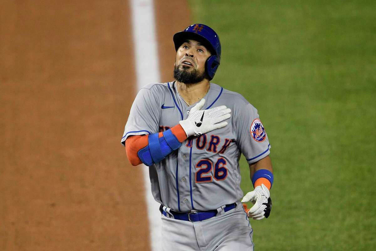 New York Mets' Robinson Chirinos celebrates his two-run home run during the fifth inning of the team's baseball game against the Washington Nationals, Thursday, Sept. 24, 2020, in Washington. (AP Photo/Nick Wass)