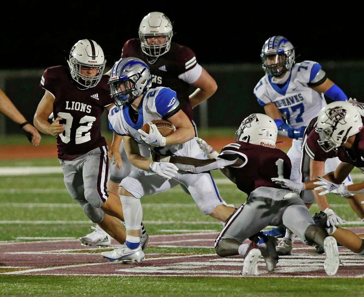 Randolph RB Colton Howard breaks a tackle from SA Christian Shay Allen. Randolph at San Antonio Christian on Thursday, September 24, 2020. Randolph 34, San Antonio Christian 0 at halftime.