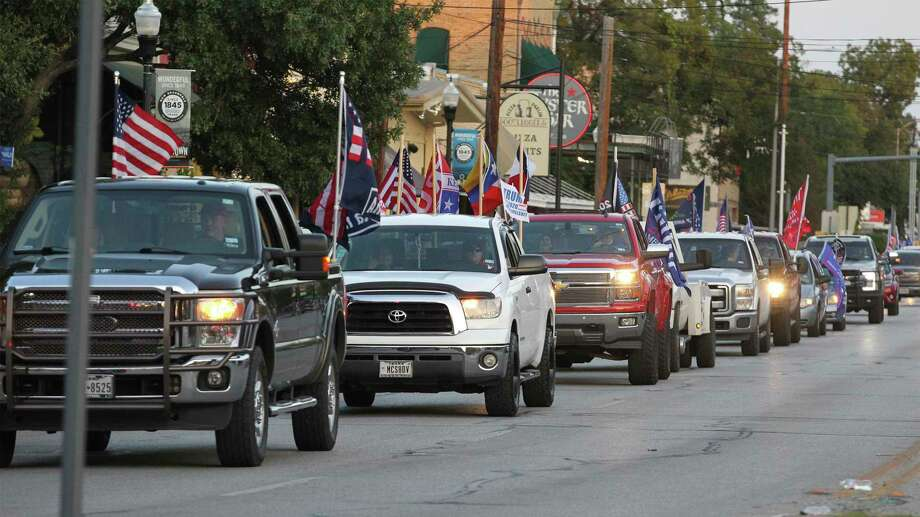 The Trump Train makes its way through downtown New Braunfels on Thursday. Photo: Tom Reel /Staff Photographer / **MANDATORY CREDIT FOR PHOTOG AND  SAN ANTONIO EXPRESS-NEWS/NO SALES/MAGS OUT/TV