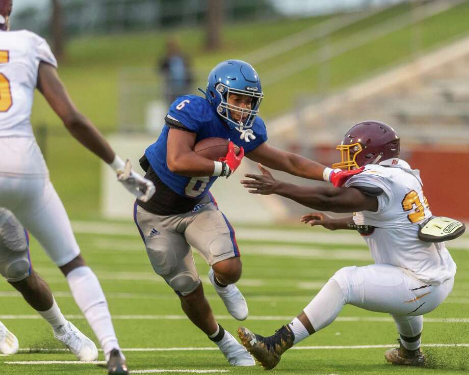 Bruins Jordan Guidry (6) pushes his way through a hole in the line in the first quarter as the Beaumont United Timberwolves and the West Brook Bruins squared off in the Alumni Bowl Scrimmage at BISD Memorial Stadium on Thursday night. Photo made on September 24, 2020.  Fran Ruchalski/The Enterprise Photo: Fran Ruchalski, The Enterprise / The Enterprise / © 2020 The Beaumont Enterprise
