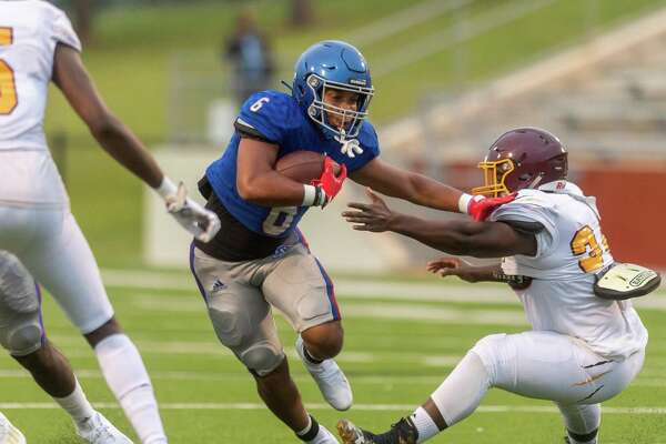 Bruins Jordan Guidry (6) pushes his way through a hole in the line in the first quarter as the Beaumont United Timberwolves and the West Brook Bruins squared off in the Alumni Bowl Scrimmage at BISD Memorial Stadium on Thursday night. Photo made on September 24, 2020. Fran Ruchalski/The Enterprise