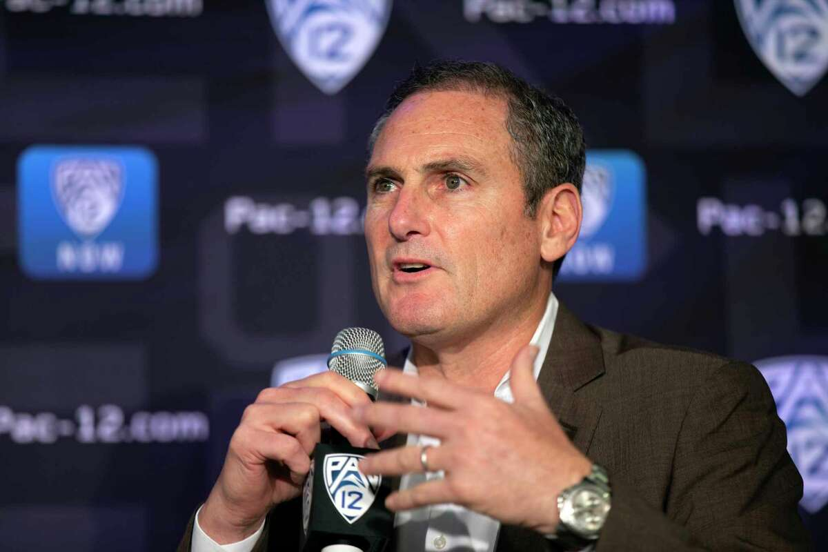 FILE - In this Oct. 7, 2019, file photo, Pac-12 Commissioner Larry Scott speaks to reporters during the Pac-12 Conference women's NCAA college basketball media day in San Francisco. The Pac-12 university presidents and chancellors will meet Friday, Sept. 17, 2020, and be presented options for staging a fall football season, but Commissioner Larry Scott says a vote by the the CEO Group is not expected. (AP Photo/D. Ross Cameron, File)