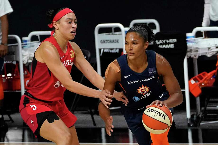 Connecticut Sun forward Alyssa Thomas (25) drives around Las Vegas Aces forward Dearica Hamby (5) during the first half of Game 3 of a WNBA basketball semifinal round playoff series Thursday, Sept. 24, 2020, in Bradenton, Fla. (AP Photo/Chris O'Meara) Photo: Chris O'Meara / Associated Press / Copyright 2020 The Associated Press. All rights reserved.
