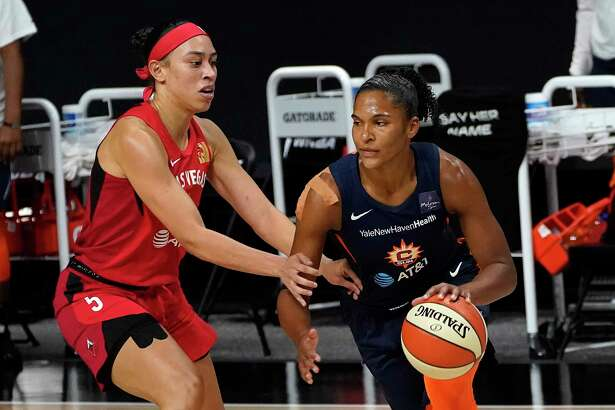 Connecticut Sun forward Alyssa Thomas (25) drives around Las Vegas Aces forward Dearica Hamby (5) during the first half of Game 3 of a WNBA basketball semifinal round playoff series Thursday, Sept. 24, 2020, in Bradenton, Fla. (AP Photo/Chris O'Meara)