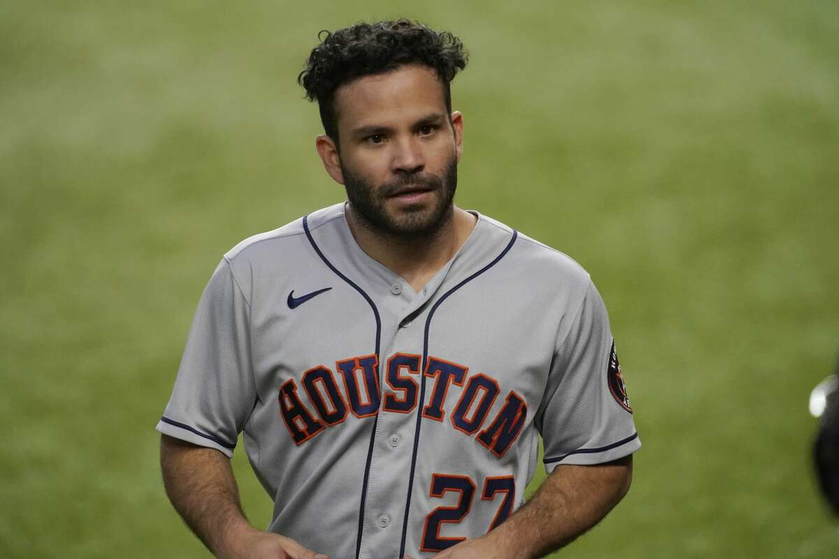 Houston Astros' Jose Altuve walks to the dugout after scoring on a triple by Alex Bregman during the first inning of the team's baseball game against the Texas Rangers in Arlington, Texas, Thursday, Sept. 24, 2020. (AP Photo/Tony Gutierrez)
