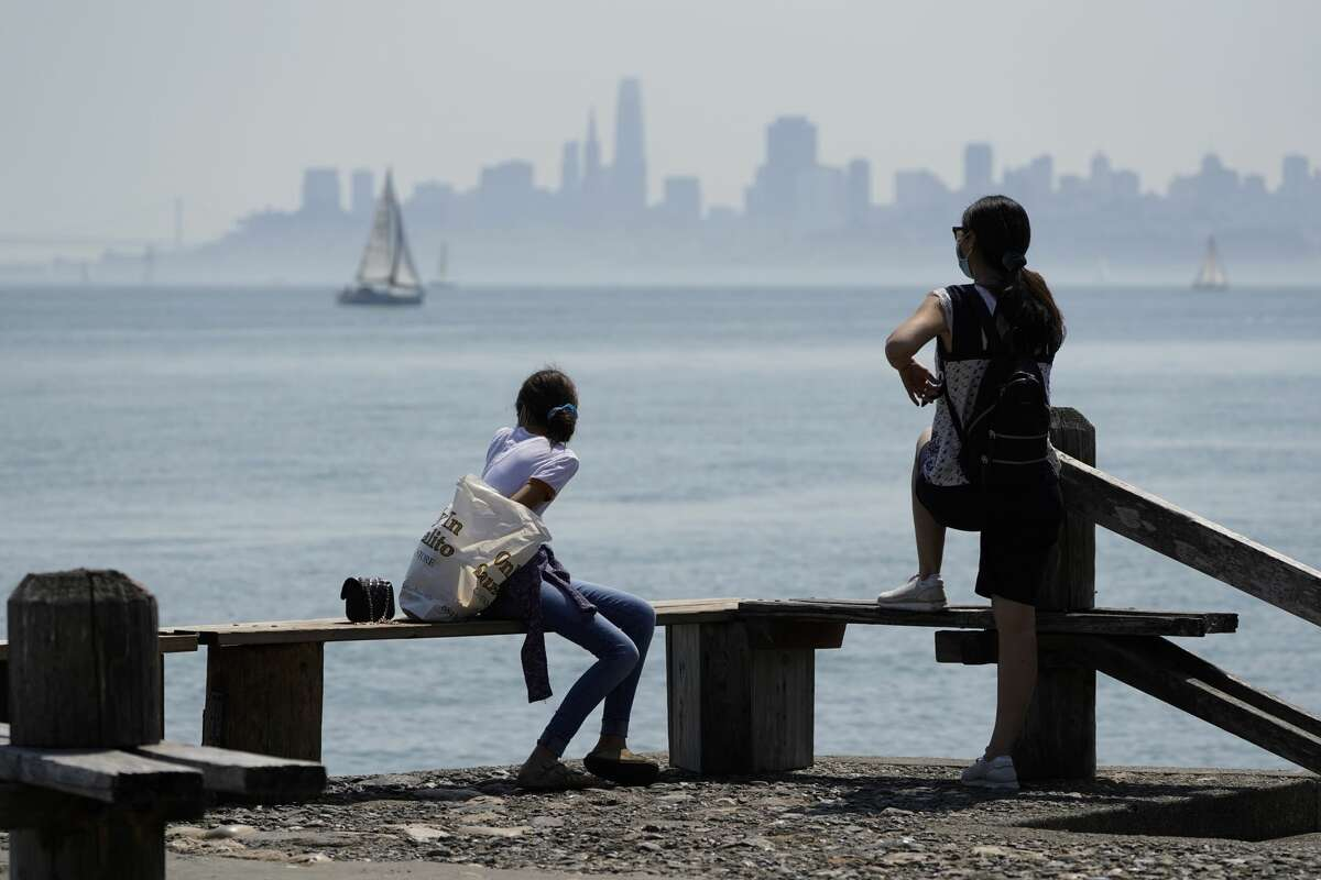 FILE - People look out at the view of San Francisco Bay Saturday, Sept. 5, 2020, in Sausalito, Calif.
