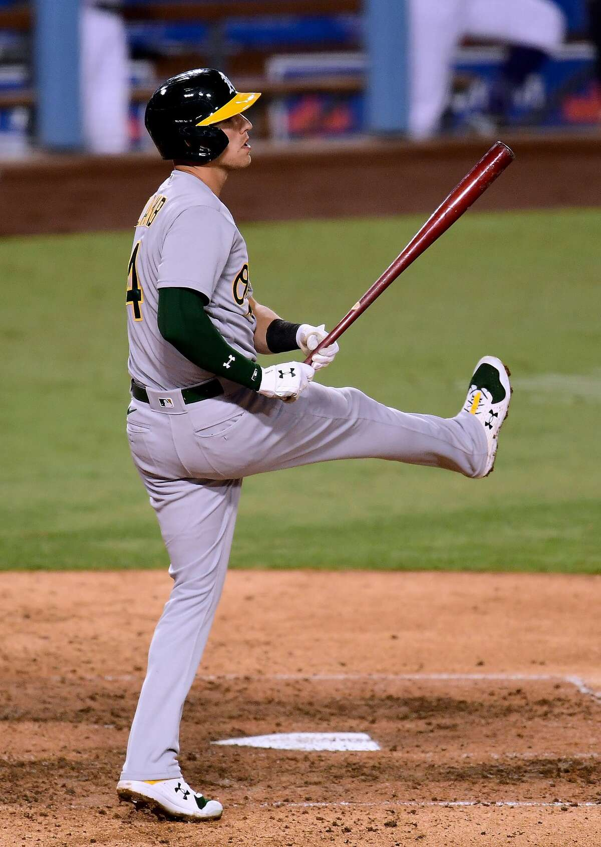 A's third baseman Jake Lamb reacts after striking out in the seventh inning. It was one of Oakland's 16 strikeouts.