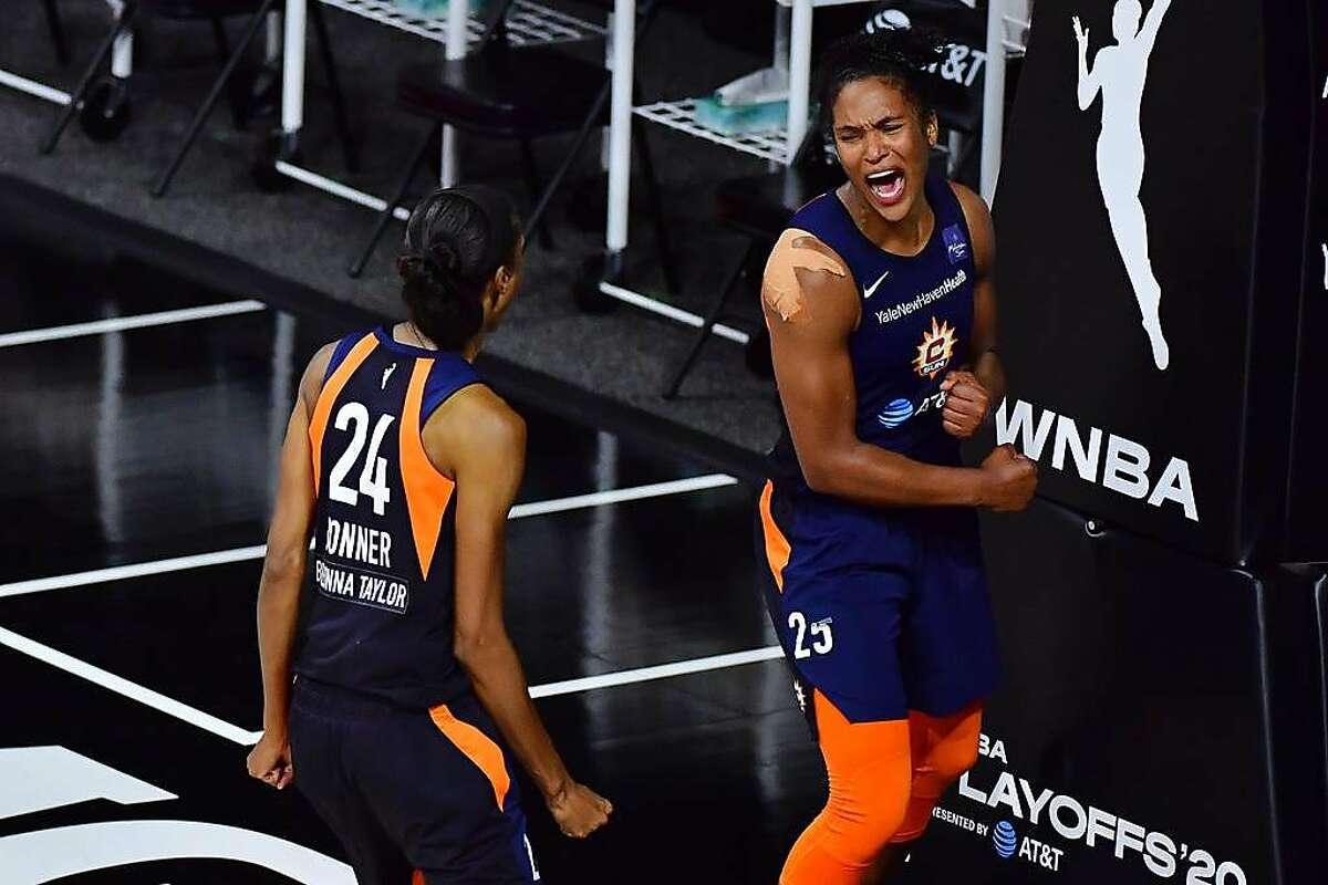 Alyssa Thomas (right) of the Connecticut Sun celebrates with DeWanna Bonner during the fourth quarter against Las Vegas.