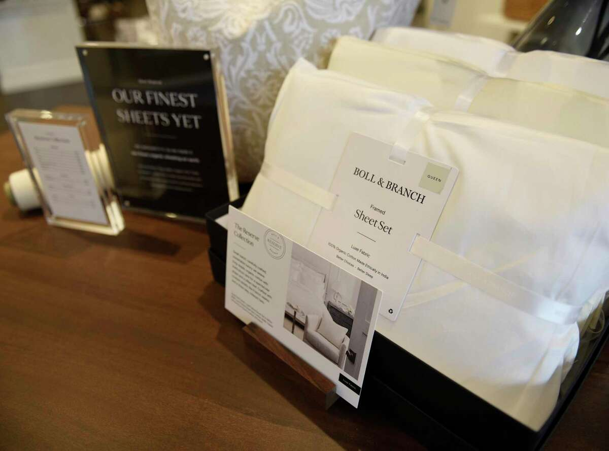 Luxury bedding products are displayed at the new Boll & Branch store located at 169 Greenwich Ave. in Greenwich, Conn. Tuesday, Sept. 24, 2020.