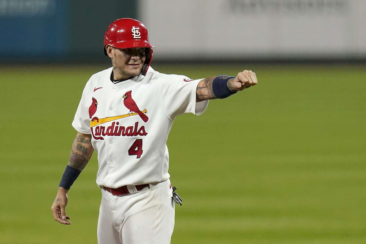 St. Louis Cardinals' Yadier Molina celebrates after hitting a single for his 2,000th career hit during the seventh inning of a baseball game against the Milwaukee Brewers Thursday, Sept. 24, 2020, in St. Louis. (AP Photo/Jeff Roberson)