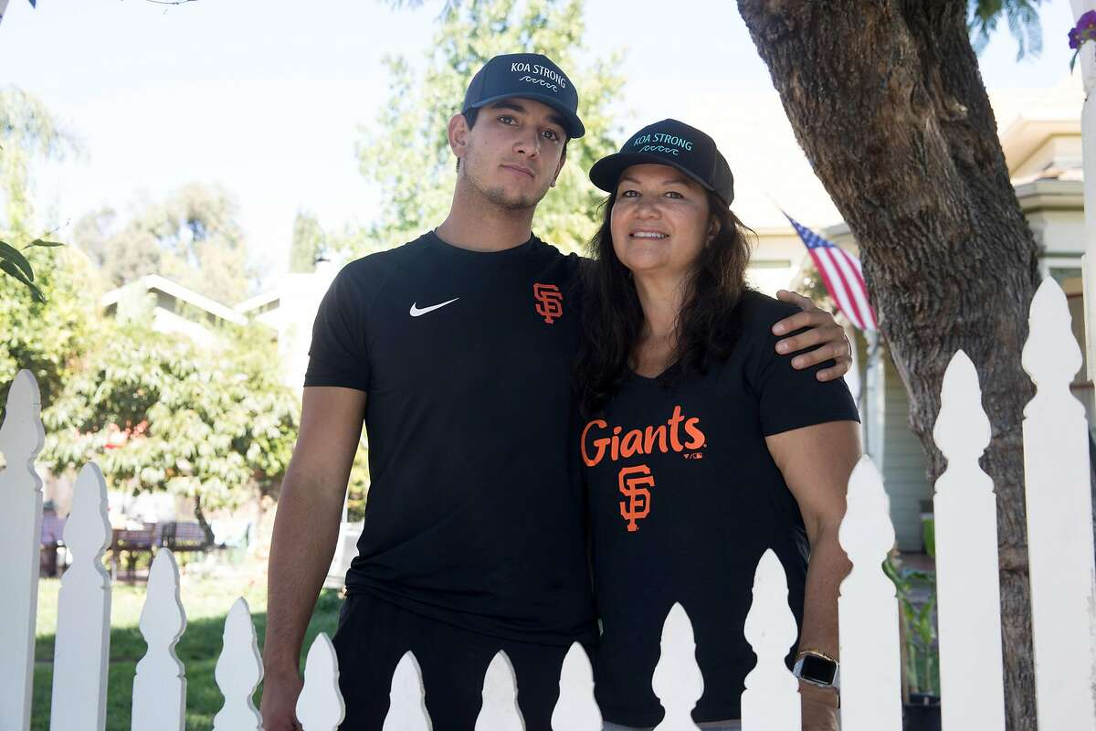 San Francisco Giants minor league pitcher Kanoa Pagán poses for a photo with his mother Lisa at their house in Campbell, Calif., on September 22, 2020. Pagán had his second minor league season canceled because of the COVID-19 pandemic. His family has also dealt with the tragic death of his 8-year-old brother Koa, who suddenly passed due to leukemia in April.