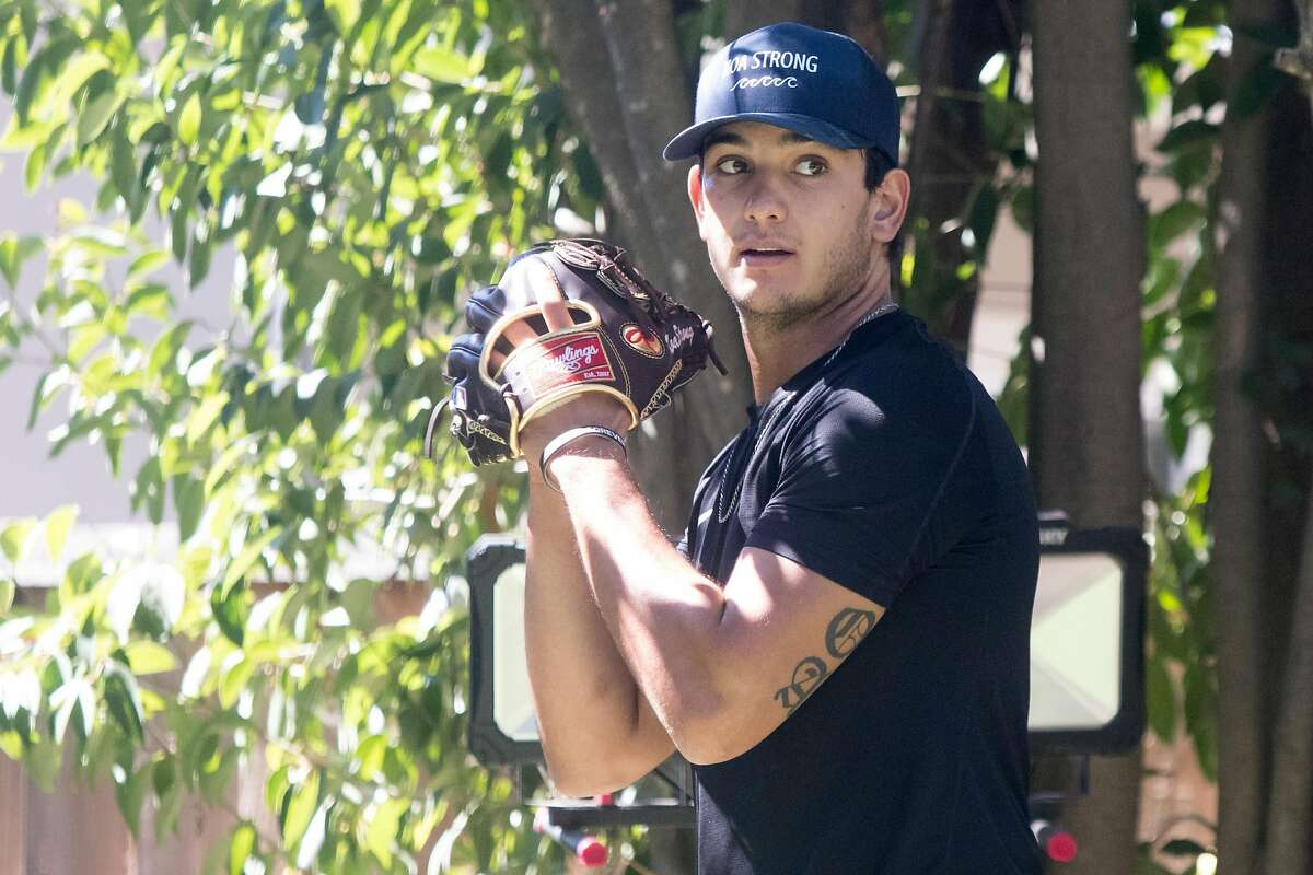 San Francisco Giants minor league pitcher Kanoa Pagán throws a session with his pitching coach Nick Sanzeri in Campbell, Calif., on September 22, 2020.