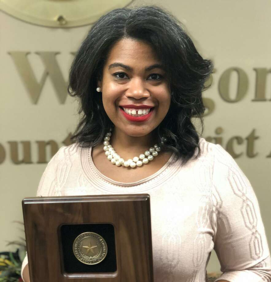 Montgomery County Assistant District Attorney Tiana Sanford is seen Sept. 17 holding an award she received from the Texas County and District Attorneys Association. Photo: Courtesy Of The Montgomery County District Attorney's Office