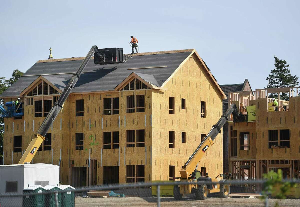 The new Windward Commons apartments are under construction on the site of the former Marina Village public housing project in Bridgeport, Conn. on Tuesday, Sept. 22, 2020.
