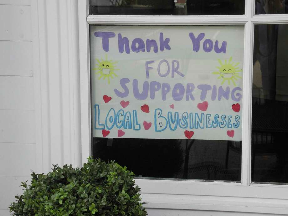 A sign in the window of Marly's Bar & Bistro in Wilton Center, from May 2020, expresses the sentiments of many businesses in town. Under Phase 3, restaurants will now be allowed greater capacity. Photo: Jeannette Ross / Hearst Connecticut Media / Wilton Bulletin