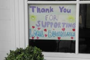 A sign in the window of Marly's Bar & Bistro in Wilton Center, from May 2020, expresses the sentiments of many businesses in town. Under Phase 3, restaurants will now be allowed greater capacity.
