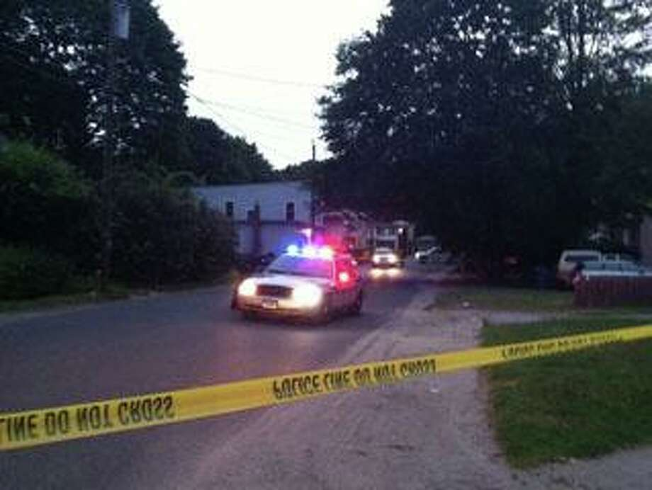 Police at the scene of a crime in Waterbury. Photo: File Photo / Connecticut Post Contributed