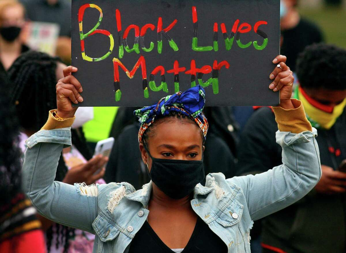Daphnee Nicolas, of New Haven, joins hundreds of Black Lives Matter protesters who gathered on the New Haven Green to hold a rally in honor of Breonna Taylor in New Haven on Thursday.