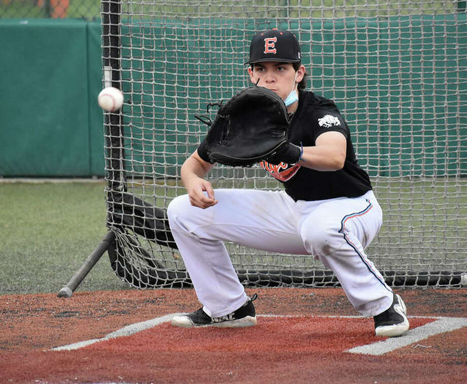 Edwardsville catcher Zak Zoelker receives a pitch during a drill Wednesday during his team's first contact day of the period. Web gallery for EHS baseball practice Photo: Matt Kamp|The Intelligencer
