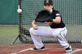 Edwardsville catcher Zak Zoelker receives a pitch during a drill Wednesday during his team's first contact day of the period. Web gallery for EHS baseball practice