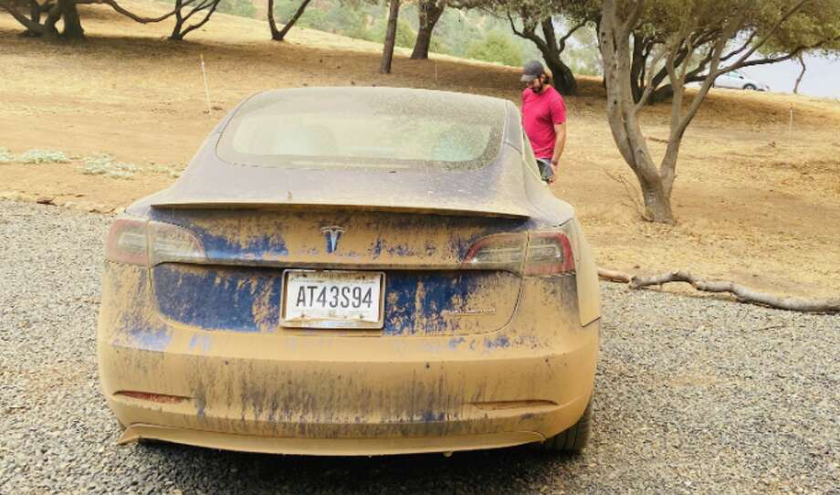 Willie Morris stands by an off-roading Tesla. Photo: Ashley Harrell
