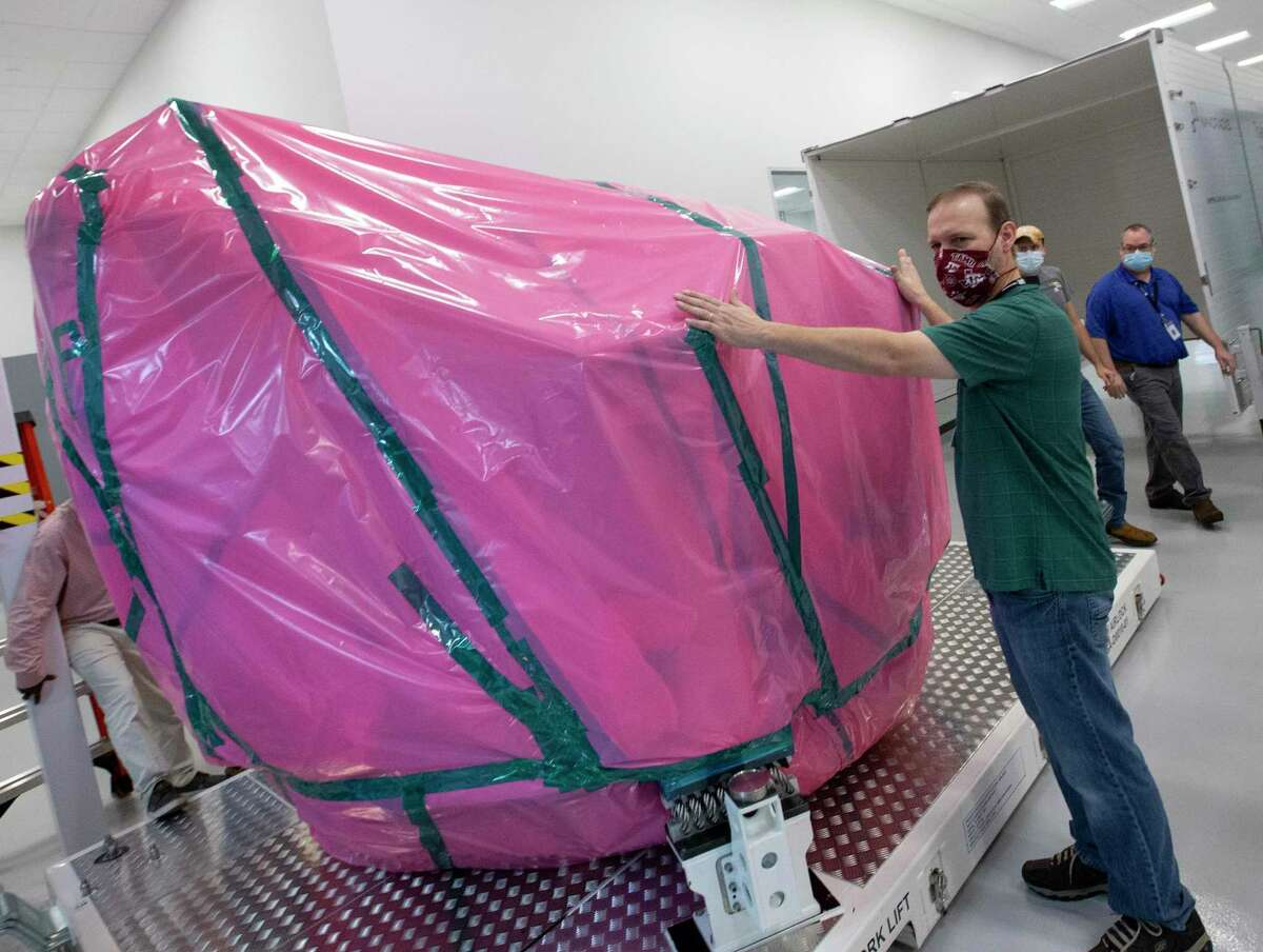 Nanoracks Director of Engineering Steven Stenzel coordinates with coworkers on how to put the Bishop Airlock into the customized container before shipping it to Florida, Wednesday, Sept. 23, 2020, in Webster.