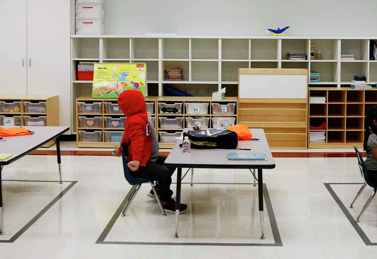 Houston ISD families now have until Monday to decide whether to send their children back to campuses like Seguin Elementary School, where a student is pictured in early September.
