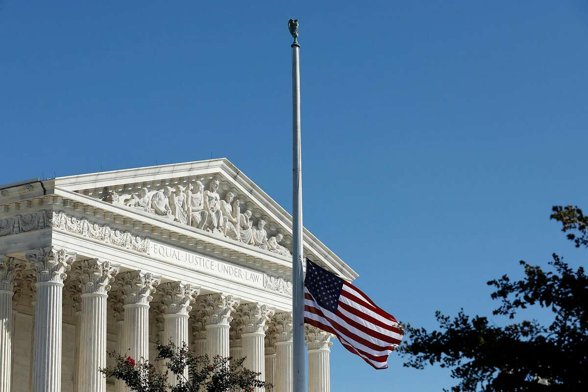 The American flag flies at half staff in memory of late Justice Ruth Bader Ginsburg outside the Supreme Court in Washington, D.C.