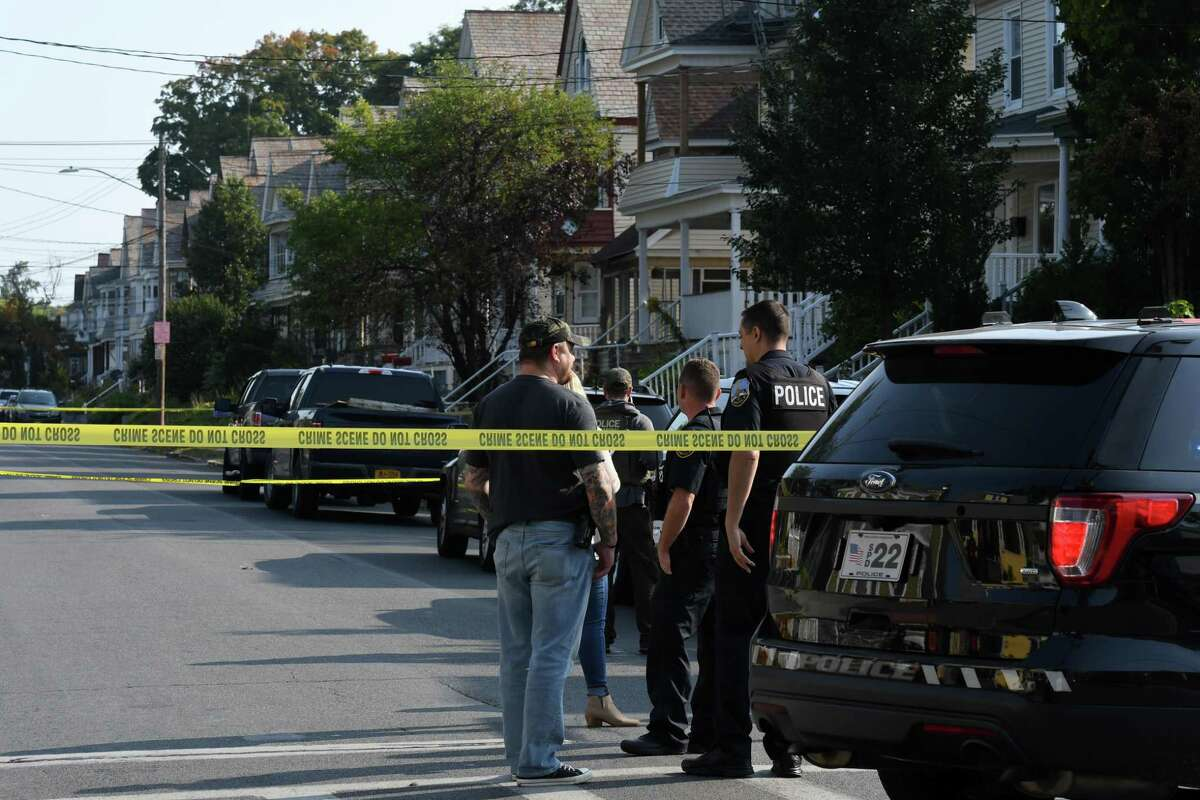 Schenectady police gather at the scene of a standoff on Friday, Sept. 25, 2020, on North Brandywine Avenue between Bradley Street and Eastern Avenue in Schenectady, N.Y. (Will Waldron/Times Union)
