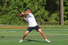 Justin Keller throws a pass during a Ridgefield football practice this week.