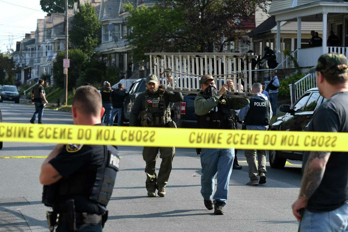 Schenectady police leave the scene of a standoff on Friday, Sept. 25, 2020, on North Brandywine Avenue between Bradley Street and Eastern Avenue in Schenectady, N.Y. (Will Waldron/Times Union)