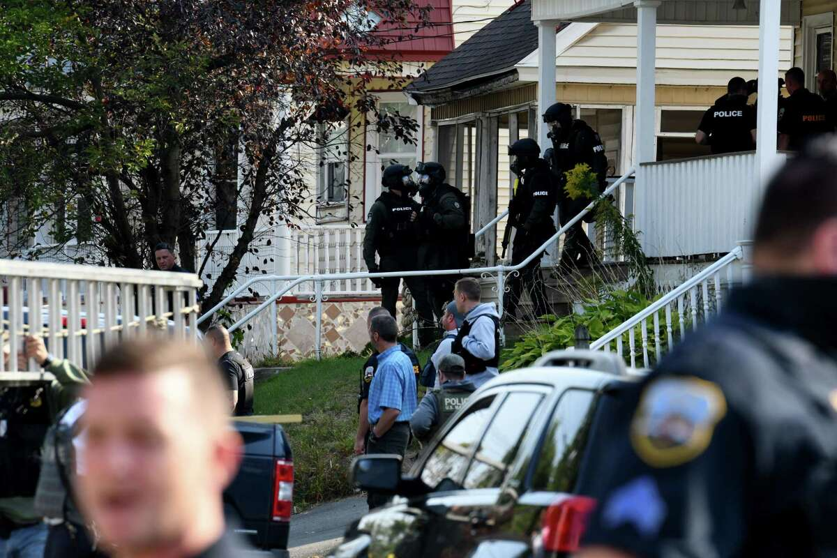 Schenectady police leave the scene of a standoff on Friday, Sept. 25, 2020, on North Brandywine Avenue between Bradley Street and Eastern Avenue in Schenectady, N.Y. A man was led out of the house by police but further details weren't available. (Will Waldron/Times Union)