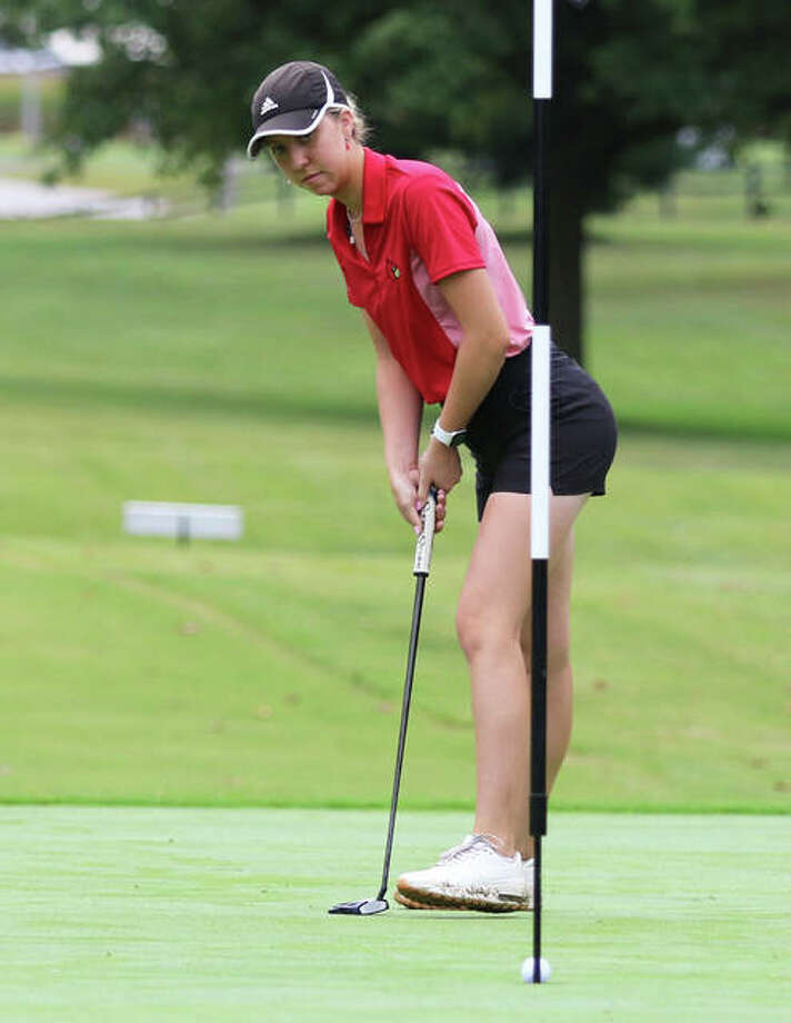 Alton's Natalie Messinger, shown sinking a putt for par in the SWC Tourney at Belk Park on Sept. 1, shot a 37 Thursday at Rolling Hills in the Redbirds' dual win over Father McGivney in Godfrey. Photo: Greg Shashack | The Telegraph
