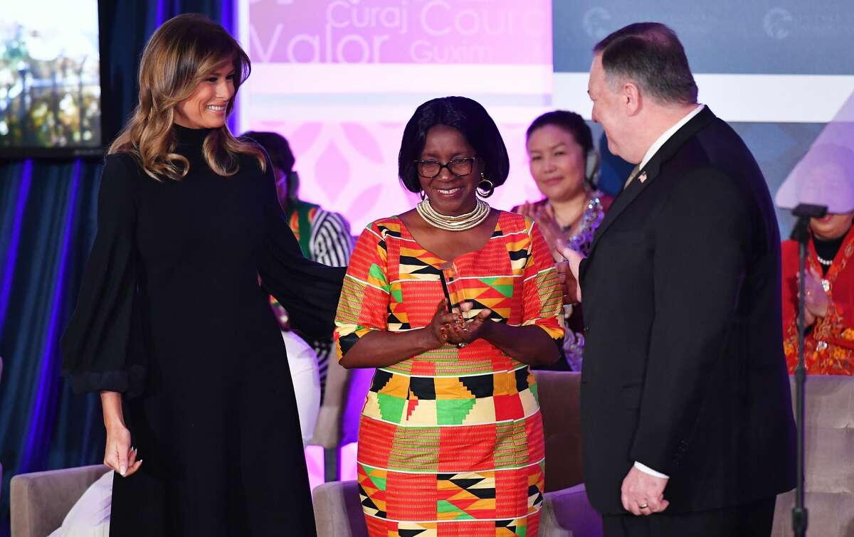 International Women of Courage (IWOC) Award recipient Rita Nyampinga of Zimbabwe poses with US Secretary of State Mike Pompeo (right) and First Lady Melania Trump at the State Department in Washington, DC on March 4, 2020.