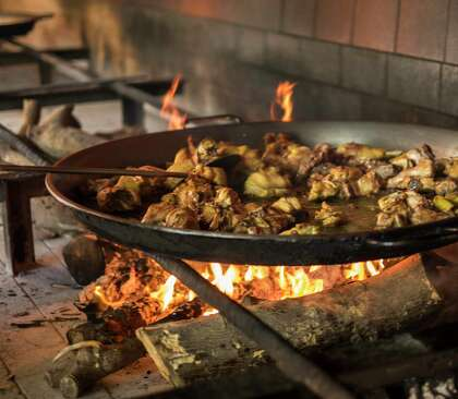 Carbon steel paella pans are safe and easy to use over open fires.