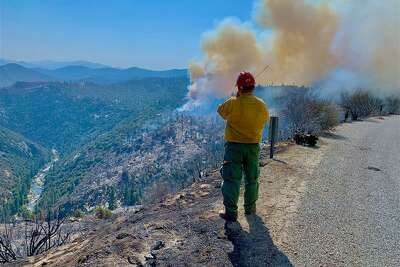 FILE - The National Interagency Fire Center announced Wednesday it has requested fire personnel from Canada & U.S. Military to assist with wildfires in California and Oregon, along with five crews totaling 100 firefighters and four agency reps from Guadalajara, Mexico.
