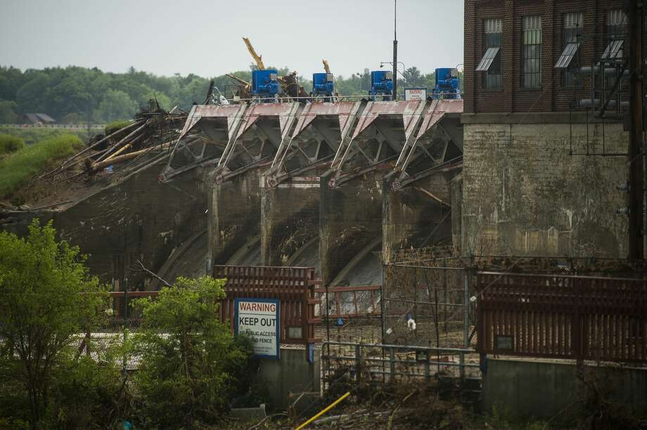 The Sanford Dam is seen as rain falls during a severe thunderstorm warning Wednesday, June 10. (Katy Kildee/kkildee@mdn.net) Photo: (Katy Kildee/kkildee@mdn.net)