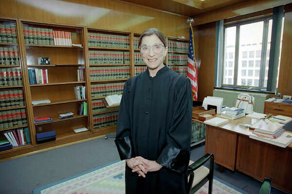 The late Supreme Court Justice Ruth Bader Ginsburg, then a judge in this Aug. 3, 1993, file photo, poses in her robe in her office at U.S. District Court in Washington. Ginsburg was the nation's 107th justice and the second woman to serve on the Supreme Court. She died Sept. 18. President Donald Trump has said he plans to announce his selection to replace her on Saturday.