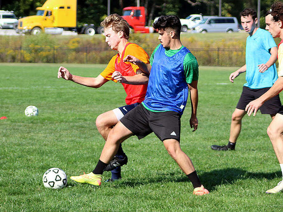 A pair of Lewis and Clark players battle for the ball during a drill Thursday at Tim Rooney Stadium. Thursday was the first day of fall offseason practice for sports at LCCC. Photo: Pete Hayes | The Telegraph